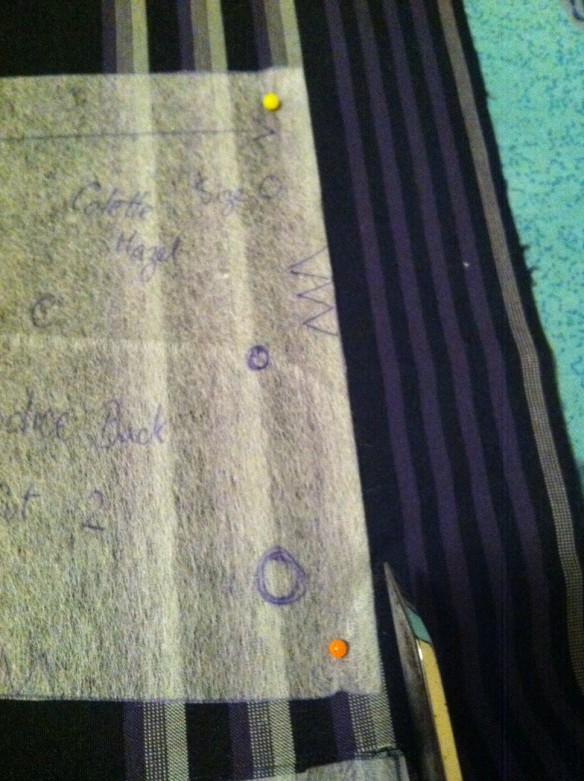 Cutting out on the ironing board