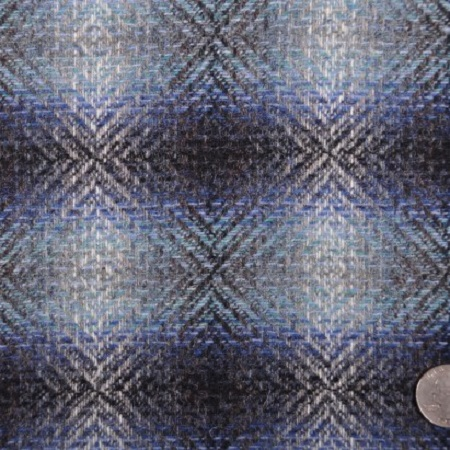 Italian Carolina Herrera Black/White/Blended Blue Plaid Suiting from Mood Fabrics