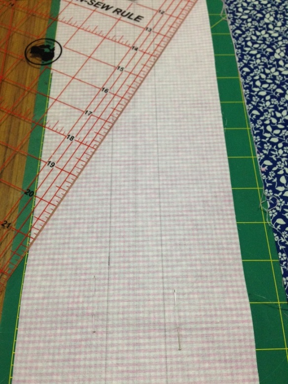 You will need add seam allowances to the pattern buttonbands. The centre line is what you will cut down to create two bands. The outer lines are your stitching lines.